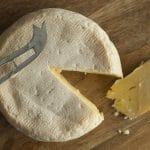 Reblochon de Savoie cheese with a slice