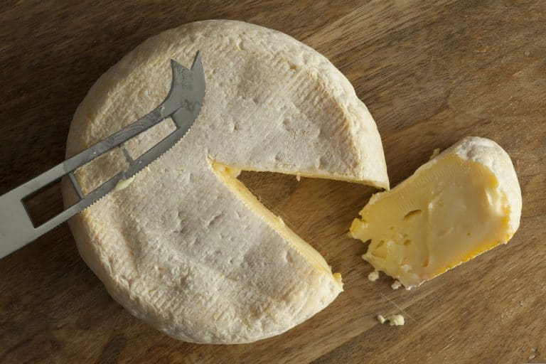 Reblochon de Savoie cheese with a slice